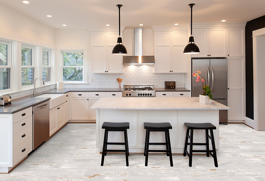 2020 themed kitchen that incorporates a white design style with white marble countertops, white cabinets, and tile floors.